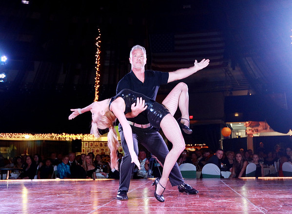 Joe Meade and Dawn Paine Orlando Usan and Kim Shingledecker perform during the  6th annual United Way of Southern West Virginia's Dancing With the Stars at the Beckley-Raleigh County Convention Center in Beckley on Friday. (Chris Jackson/The Register-Herald)