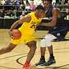 (Brad Davis/The Register-Herald) Oak Hill Academy's Billy Preston drives as Blue Ridge School's Richard Amaefule defends during the Big Atlantic Classic national game Wednesday night at the Beckley-Raleigh County Convention Center.