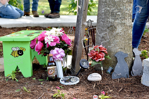 """(Brad Davis/The Register-Herald) Decorations under a special tree decorated in memory of the late Belinda Scott, part of what will now be known as """"Belinda's Honeybee Garden"""" inside the new Brad Paisley Park Friday afternoon in White Sulphur Springs."""