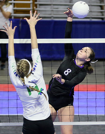 (Brad Davis/The Register-Herald) James Monroe's Jessica King goes for the kill against Robert C. Byrd during State Volleyball Tournament action Friday afternoon at the Charleston Civic Center.
