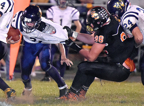 (Brad Davis/The Register-Herald) Greenbrier West's Chad Ramsey is taken down by Summers County's Andrew Richmond Friday night in Hinton.
