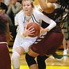 (Brad Davis/The Register-Herald) Greenbrier East's Haley McClure powers her way to the basket around Woodrow Wilson defender Jamara Walton Saturday night in Fairlea.