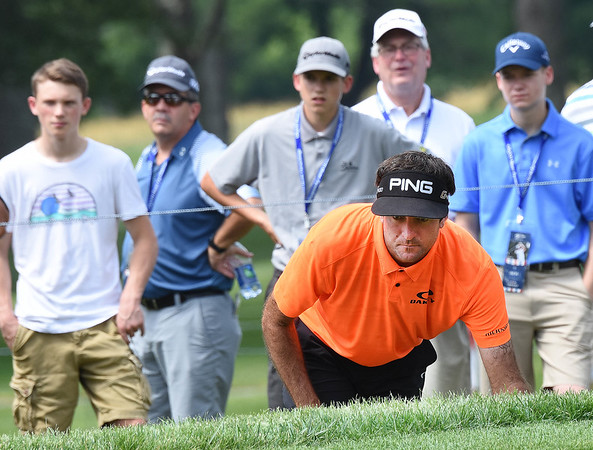 Bubba Watson looks over his birdie putt on the par 4, 4th hole during the first round of, A Military Tribute at The Greenbrier golf tournament.<br /> (Rick Barbero/The Register-Herald)