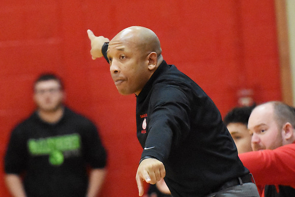 Oak Hill boys basketball head coach Benitez Jackson  motions to his side during the second quarter of their basketball game against Cabell Midland in Oak Hill on Tuesday. (Chris Jackson/The Register-Herald)