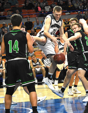 Jacob Ellis, of Westside, struggles to get the ball against Winfield defenders during the quarter-finals of the Class AA Boys State Basketball Tournament held at the Charleston Civic Center. Winfield won 68-65<br /> (Rick Barbero/The Register-Herald)