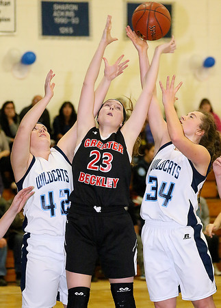 (Brad Davis/The Register-Herald) Greater Beckley Christian's Abigail Hill, middle, leaps for a rebound with Meadow Bridge's Chasity Ballenger, left, and Shauna Harless Thursday night in Meadow Bridge.