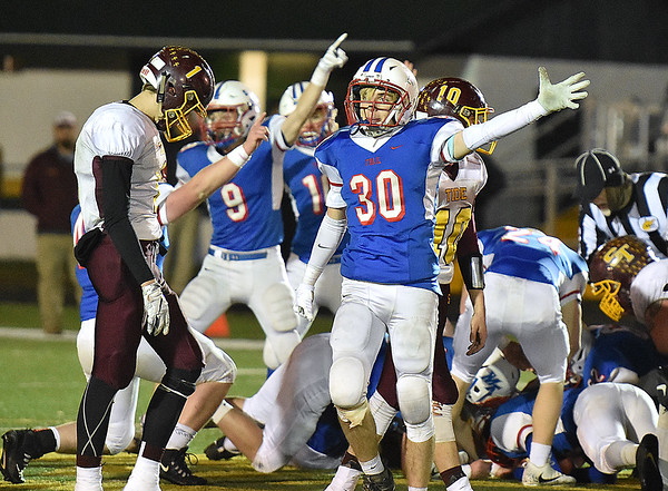 (Brad Davis/The Register-Herald) Midland Trail's Tyler Brasse (#30) signals a first down along with his defensive teammates after forcing a 3rd quarter fumble and recovering it Friday night in Fairlea.