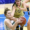 (Brad Davis/The Register-Herald) Wyoming East's Allie Lusk scraps for a loose ball with Lincoln's Hannah Ferris Wednesday afternoon at the Charleston Civic Center.