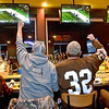 (Brad Davis/The Register-Herald) Football fans Eric Wallace (fist raised left) and Charles March (fist raised right) react to events on the field as they take in the Super Bowl accompanied by Alexis Basconi, far left, and Natasha Wickline, far right, Sunday night at Buffalo Wild Wings.