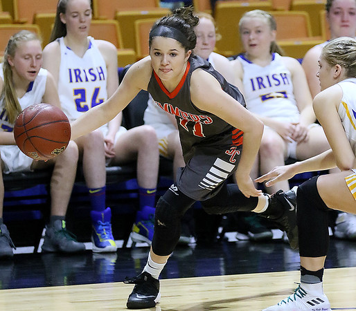 (Brad Davis/The Register-Herald) Summers County's Taylor Isaac drives around St. Joseph Central's Laney Whitmore Friday night at the Charleston Civic Center.