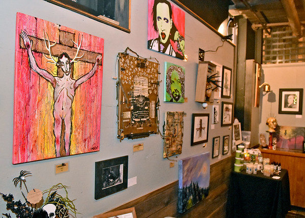 (Brad Davis/The Register-Herald) Some of the works on display by area artisans during Treehouse Arts' Dark Arts Show Friday evening at Brown Dog Bottom in the Underground.