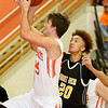 (Brad Davis/The Register-Herald) Summers County's Jamison Hamm drives to the basket as Mount View's Aaric Gross defends Wednesday night in Hinton.