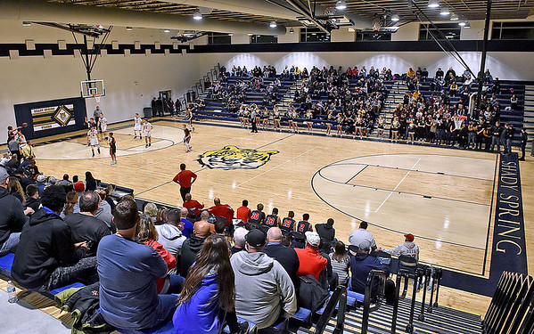 (Brad Davis/The Register-Herald) Fans and family of Poca and Shady Spring fill the stands as they watch the game inside the Tigers' brand new gymnasium Wednesday night in Shady Spring.