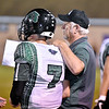 (Brad Davis/The Register-Herald) Wyoming East head coach Donald Jewell talks with quarterback Seth Ross before going out for another series Friday night in Lindside.