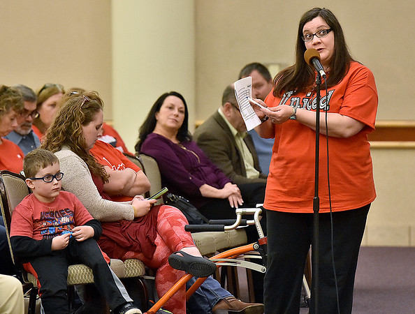 (Brad Davis/The Register-Herald) Wendy Peters comments on her concerns over PEIA during a public hearing Wednesday night at Tamarack.