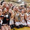(Brad Davis/The Register-Herald) The Summers County Lady Bobcats celebrate with their new hardware after defeating Pocahontas County for the Regional Championship and a trip back to the State Tournament Wednesday night in Hinton.