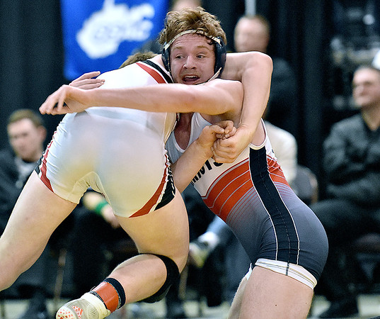 (Brad Davis/The Register-Herald) Independence's Adam Daniels takes on Nitro's Paul Frampton for the Class AA/A 182-pound championship during State Wrestling Tournament action Saturday night at the Big Sandy Arena. Nitro's Frampton won the match.