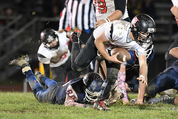 Ian Sloan, of Liberty, right, pick up a fumble and breaks away from Niko Burgess, of Independence during first half action at Independence High School Friday night.<br /> (Rick Barbero/The Register-Herald