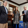 (Brad Davis/The Register-Herald) United Way of Southern West Virginia Executive Director Michelle Rotellini announces the organization's achievment of reaching its yearly fundraising goal flanked by this year's campaign chair Austin Caperton, right, and incoming campaign chair Donnie Holcomb Friday afternoon following the announcement at their Croft Street headquarters.