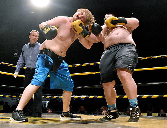 "(Brad Davis/The Register-Herald) Chris Miles, right, connects on a devastating right upper cut to opponent Ronnie Barker during their match in the ""Original"" Toughman Contest Saturday night at the Beckley-Raleigh County Convention Center."