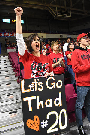 Stephanis Jordan, mother of Thad Jordan of Greater Beckley Christian root for thr Crusaders against Tug Valley during the quarter-final game of the Class A Boys State Basketball Tournament held at the Charleston Civic Center. Tug Valley won 83-52<br /> (Rick Barbero/The Register-Herald)