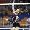 (Brad Davis/The Register-Herald) Woodrow Wilson's Sophia Booth spikes the ball against University during State Volleyball Tournament action Friday evening at the Charleston Civic Center.