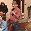 (Brad Davis/The Register-Herald) Minden resident Jerry Farley, who endured a bout with cancer four years ago, asks questions during the comment portion of a public meeting between town residents and officials from state and federal agencies tasked with investigating the presence of PCB's there Friday night at New Beginning Apostolic Church.
