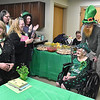 (Brad Davis/The Register-Herald) Family and friends cheer as 100-year-old Shirley Testement is brought into the room by sons (from left) John and Chester during the opening moments of her birthday party Saturday afternoon at Pine Lodge Nursing Home. The proud centurian boasts 10 children (one deceased), 27 grandchildren (one deceased), 44 great grandchildren and 19 great great grandchildren, according to the family.