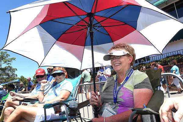 Jennie Frashier, of Ripley, watches play from the 18th green during A Military Tribute at The Greenbrier golf tournament held at The Greenbrier Resort in White Sulphur Springs.<br /> (Rick Barbero/The Register-Herald)
