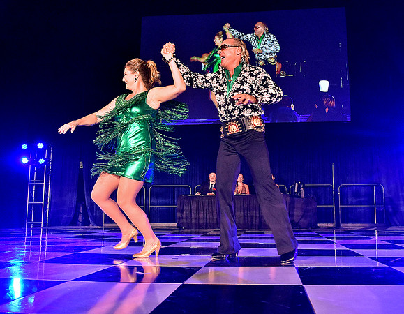 (Brad Davis/The Register-Herald) Carolyn Buzbee and Randolph McGraw, eventual winners of the 1st Place People's Choice award, perform during the United Way of Southern West Virginia's Dancing With the Stars fundraising event Friday night at the Beckley-Raleigh County Convention Center.