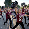 (Brad Davis/The Register-Herald) The Woodrow Wilson dance team performs on the move during the school's homecoming parade Wednesday evening in downtown Beckley.