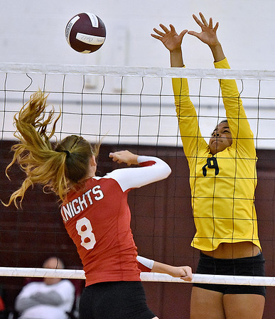 (Brad Davis/The Register-Herald) Greenbrier East's Nevaeh Wooding, right, blocks a spike attempt from Cabell Midland's Gracie Hightower during Shirley Brown Invitational action Saturday morning at Woodrow Wilson High School.