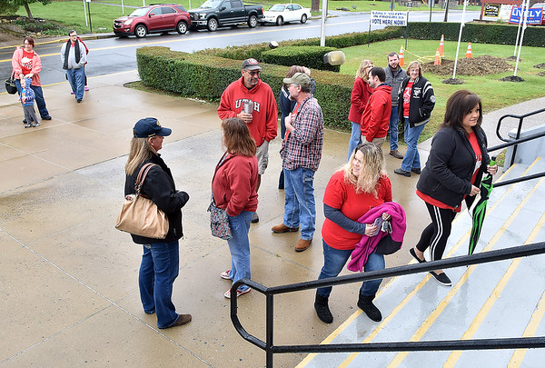 (Brad Davis/The Register-Herald) Fayette County teachers begin arriving at the Soldiers & Sailors Memorial building to cast early votes Saturday morning in Fayetteville.