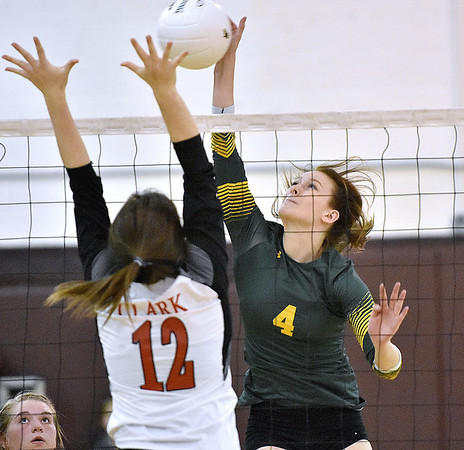 (Brad Davis/The Register-Herald) Greenbrier East's Maggie Thompson rips a spike as St. Albans' Brooke Clark leaps to block it during the Class AAA Regional Volleyball tournament Saturday afternoon in Beckley.
