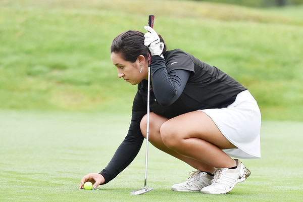 Woodrow Wilson's Mary Denny lines up her putt on the No. 10 green green during their Class AAA, Region 3 golf tournament at Pipestem Resort State Park on Monday. (Chris Jackson/The Register-Herald)