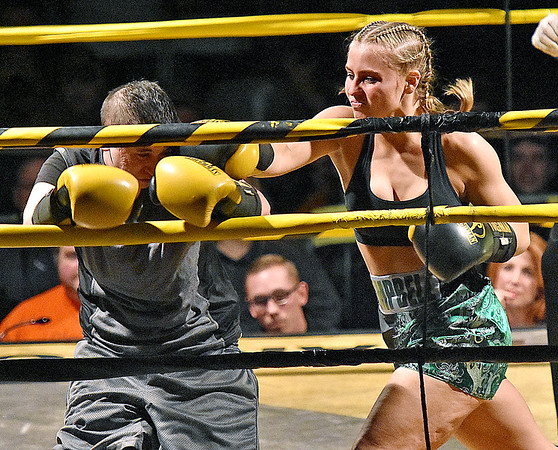 (Brad Davis/The Register-Herald) Abby Campbell, right, takes on opponent Nicole Pollutra during their match in the Original Toughman Contest Friday night at the Beckley-Raleigh County Convention Center.