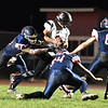 Ian Sloan, of Liberty, second from left, gets tackled by, Niko Burgess, left, Jacob Hatcher and Hunter Williams, of Independence during first half action at Independence High School Friday night.<br /> (Rick Barbero/The Register-Herald