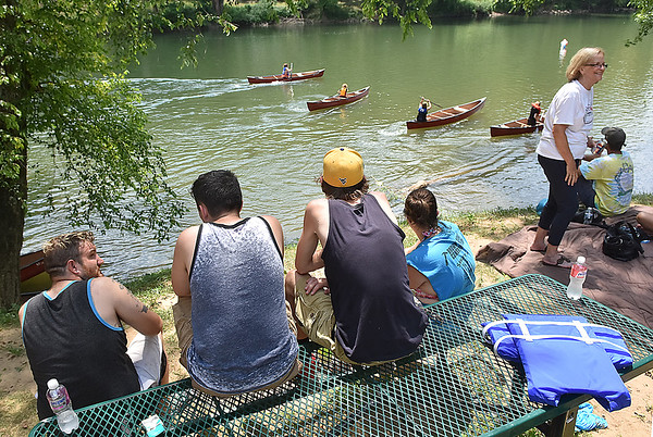 (Brad Davis/The Register-Herald) Residents take in the action as they watch their friends and neighbors compete during the annual Alderson Canoe Races Sunday afternoon, part of the town's yearly 4th of July festivities.