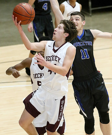 (Brad Davis/The Register-Herald) Woodrow Wilson's Danny Bickey drives and scores as Princeton's Tanner Lockart defends during the Flying Eagles' Sectional Championship win over the Tigers Friday night at the Beckley-Raleigh County Convention Center.