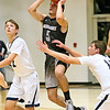 (Brad Davis/The Register-Herald) Westside's Shane Jenkins leaps to shoot the ball from mid-court before the 1st quarter buzzer to make the shot as Shady Spring's Tommy Williams, left, and Erick Bevil defend Wednesday night in Shady Spring.
