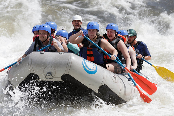 Rafters paddle their craft through the remainder of Sweet's Falls, Class V rapid on the Upper Gauley River. Chad Foreman for the Register-Herald.