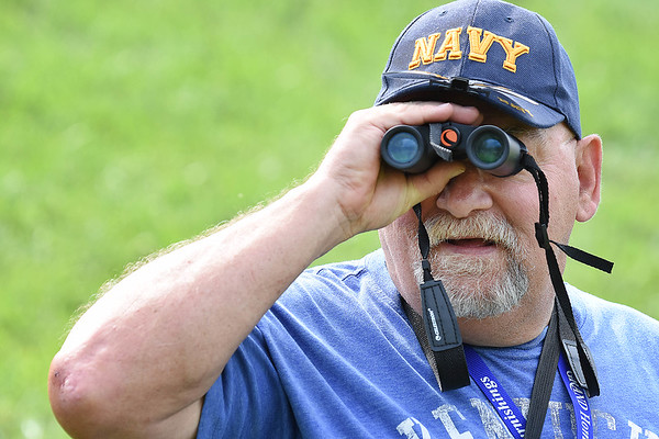 A.J. Jacobs, of Greenup, Ky, watching golfers tee off on the the par 3, 18th hole during the first round of, A Military Tribute at The Greenbrier golf tournament.<br /> (Rick Barbero/The Register-Herald)