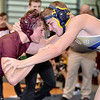 (Brad Davis/The Register-Herald) Woodrow Wilson's Zach Weaver takes on Greenbrier West's Shawn Roswell in a 152-pound weight class matchup Friday night at the Summersville Arena and Convention Center. West's Roswell would win the match.