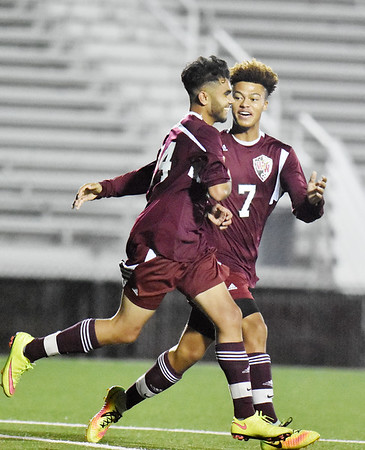 Woodrow's Mahdi Farooai (24) is congratulated by Kenny Price (7) after scoring the opening goal of their match against Shady Spring Tuesday in Beckley. (Chris Jackson/The Register-Herald)