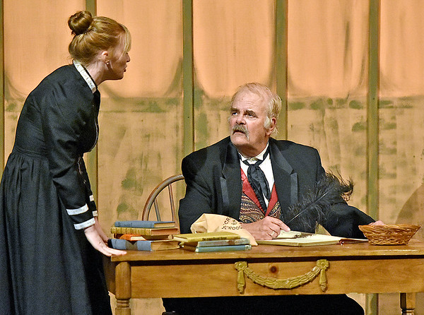 (Brad Davis/The Register-Herald) Shrwed business man Scrooge, played by Gene Worthington, is bothered at work by the discussion of Christmas during a rehearsed scene from Treehouse Arts Ensemble's production of A Christmas Carol, which opens tonight at Tamarack.