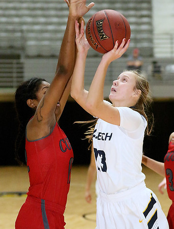 (Brad Davis/The Register-Herald) WVU Tech's Brittney Justice drives and scores as IU-Kokomo's Whitney Williams defends during the Golden Bears' win over the Cougars Saturday night at the Beckley-Raleigh County Convention Center.