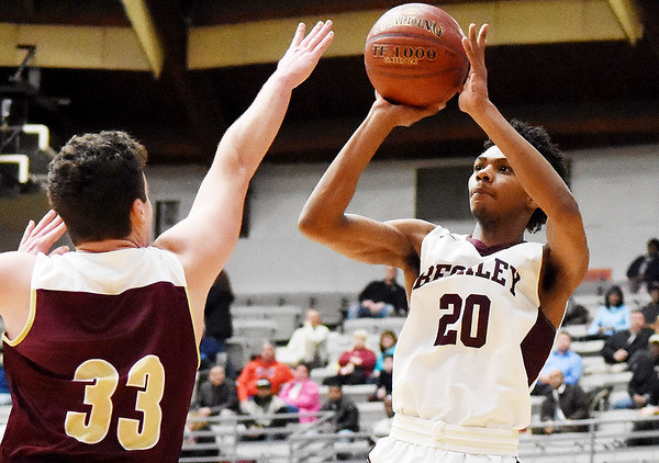 Woodrow Wilson's Mikey Penn (20) gets a shot off over  George Washington's Gus Eddy (33) during the first quarter of their high school basketball game Tuesday in Beckley. (Chris Jackson/The Register-Herald)