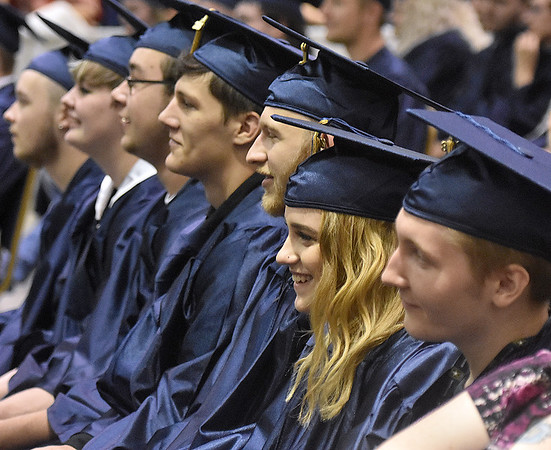 (Brad Davis/The Register-Herald) Graduating Nicholas County seniors look on during the school's commencement ceremony Sunday afternoon.
