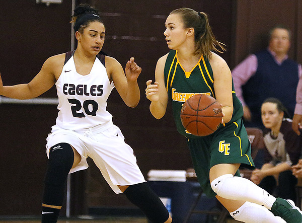 (Brad Davis/The Register-Herald) Greenbrier East's Abby Bartenslager moves along the perimeter as Woodrow Wilson's Madison Riddick defends Thursday night in Beckley.
