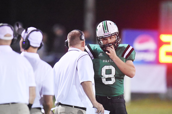 Fayetteville coach Dave Moneypenny speaks with Logan Frantz during their high school football game against Sherman Friday in Fayetteville. (Chris Jackson/The Register-Herald)
